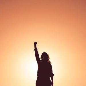 Woman Standing In Her Power with Upstretched Arm