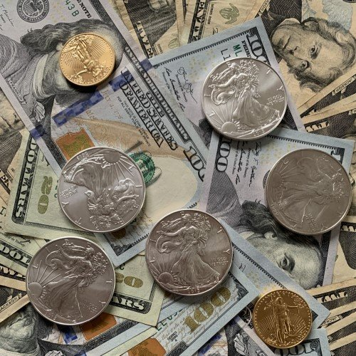 $100 Bills with Gold and Silver Coins